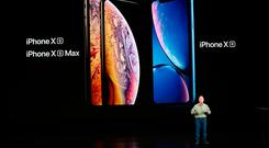 Apple's Phil Schiller introduces the new Apple iPhone XR (right) plus XS and XS Max (left) in Cupertino, California. Photo: REUTERS