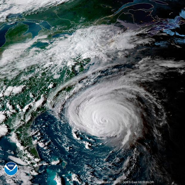 This enhanced satellite image made available by NOAA shows Hurricane Florence off the eastern coast of the United States on Wednesday, Sept. 12, 2018 at 5:52 p.m. EDT. (NOAA via AP)