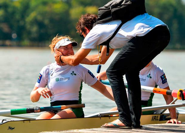 Emily Hegarty of Ireland is congratulated by coach David McGowan after winning her Women's Pair semi-final race with team-mate Aifric Keogh on day five of the World Rowing Championships in Plovdiv, Bulgaria. Photo by Seb Daly/Sportsfile
