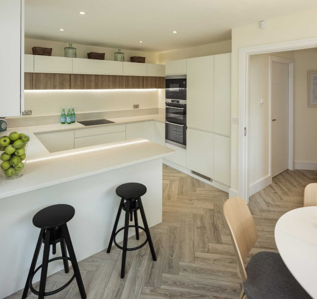 The white and walnut kitchen in SeaGreen