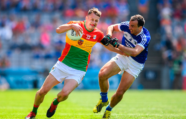 Paul Broderick of Carlow and Gareth Dillon of Laois