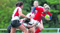 Munster's Niamh Briggs charges through the Ulster rearguard. Photo: INPHO