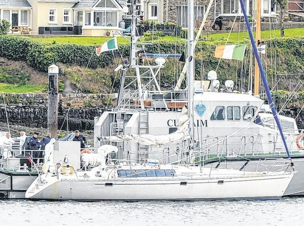 Officers carry out a forensic search of the yacht at Castlepark Marina in Kinsale. Photo: Provision