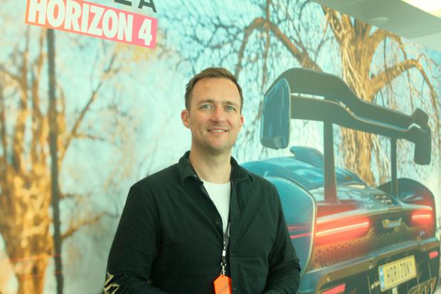 Playground Games creative director Ralph Fulton with the McLaren Senna in-game version behind him. Photo: Ronan Price