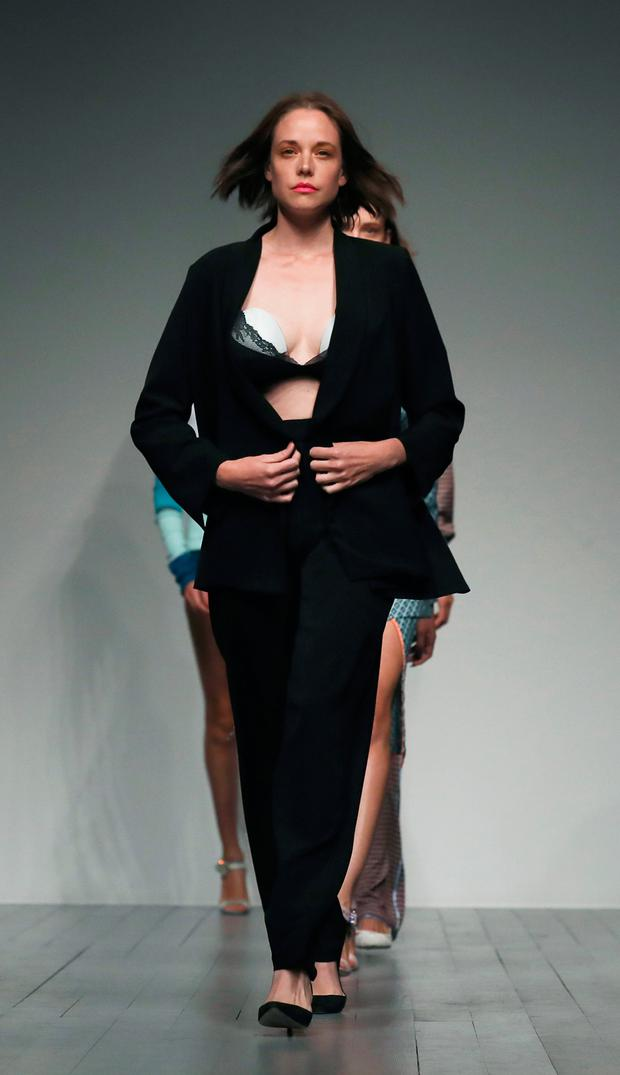 Model and new mum Valeria Garcia wearing an innovative breast pump on the catwalk during the Marta Jakubowski London Fashion Week show held at the BFC space, London. Photo: Isabel Infantes/PA Wire