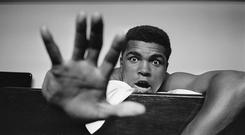 Gimme Five .... Cassius Clay (later Muhammad Ali) holding up five fingers in a prediction of how many rounds it will take him to knock out Henry Cooper