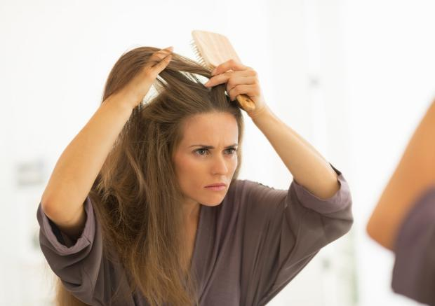 Limit the use of styling products, which may irritate the scalp. Stock image