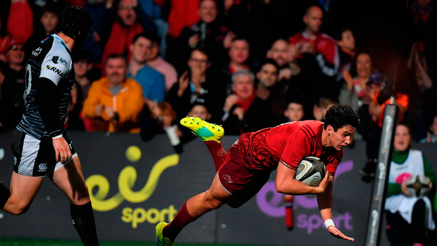 Joey Carbery of Munster goes over to score his side's second try