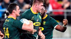 South Africa's Malcolm Marx celebrates after scoring a try with team mates Jesse Kriel and Siya Kolisi