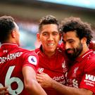 Liverpool's Roberto Firmino (centre) celebrates scoring his side's first goal of the game during the Premier League match at Wembley Stadium