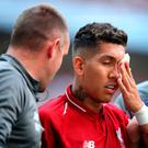 Liverpool's Roberto Firmino receives medical attention during the Premier League match at Wembley Stadium, London. PRESS ASSOCIATION Photo. Picture date: Saturday September 15, 2018. Adam Davy/PA Wire.