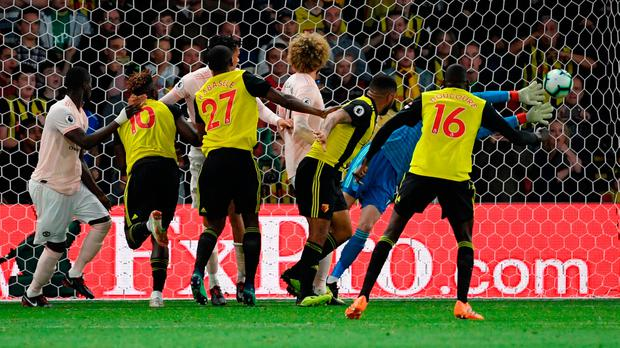 WATFORD, ENGLAND - SEPTEMBER 15: David De Gea of Manchester United saves the ball during the Premier League match between Watford FC and Manchester United at Vicarage Road on September 15, 2018 in Watford, United Kingdom. (Photo by Ross Kinnaird/Getty Images)