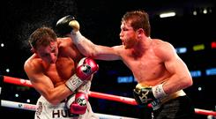 LAS VEGAS, NV - SEPTEMBER 15: Canelo Alvarez punches Gennady Golovkin during their WBC/WBA middleweight title fight at T-Mobile Arena on September 15, 2018 in Las Vegas, Nevada. (Photo by Al Bello/Getty Images)