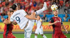 Sep 15, 2018; Toronto, Ontario, CAN; Los Angeles Galaxy forward Zlatan Ibrahimovic (9) scores a goal during the first half against Toronto FC at BMO Field. Mandatory Credit: Nick Turchiaro-USA TODAY Sports