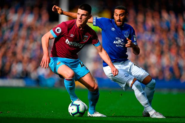 West Ham United's Declan Rice (L) vies with Everton's Cenk Tosun