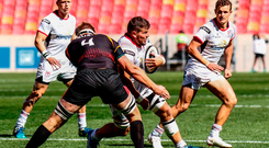 Sean Reidy of Ulster is tackled by John-Charles Astle of Southern Kings