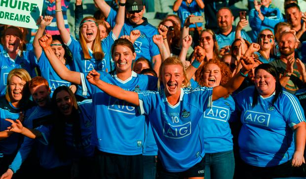 16 September 2018; Carla Rowe, right, and Oonagh Whyte of Dublin celebrate with fans following the TG4 All-Ireland Ladies Football Senior Championship Final match between Cork and Dublin at Croke Park, Dublin. Photo by David Fitzgerald/Sportsfile