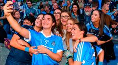 Niamh Collins of Dublin takes a selfie with supporters
