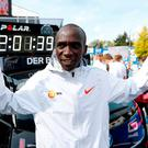 Eliud Kipchoge celebrates after setting a new marathon record in Berlin. Photo: Fabrizio Bensch/Reuters