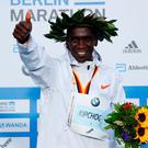 Kenya's Eliud Kipchoge celebrates after winning the Berlin Marathon and breaking the World Record. Photo: Fabrizio Bensch/Reuters