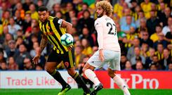 Marouane Fellaini battles it out with Troy Deeney at Vicarage Road. Photo by Ross Kinnaird/Getty Images