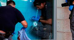 A bullet hole and bloodied clothing at the scene. Photo: Getty Images