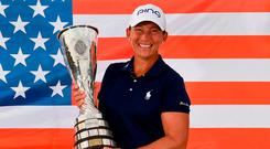 US golfer Angela Stanford poses with her trophy. Photo: Jean-Pierre Clatot/AFP/Getty Images