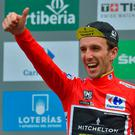 British rider Simon Yates of the Mitchelton-Scott team celebrates after his victory in La Vuelta. Photo: Ander Gillenea/AFP/Getty Images