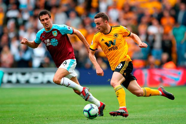 Burnley's Jack Cork (left) and Wolverhampton Wanderers' Diogo Jota battle for the ball. Photo credit: Nick Potts/PA Wire