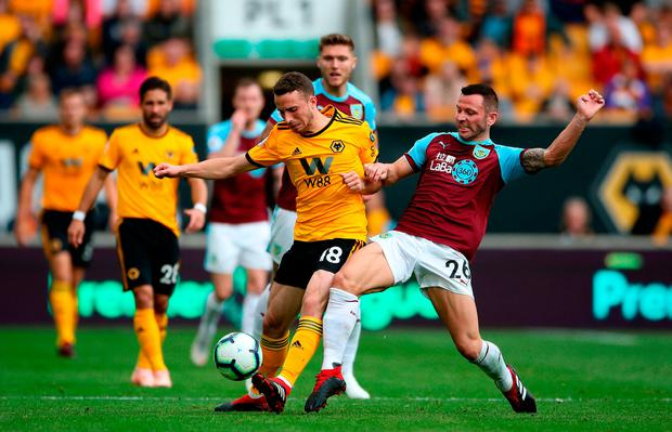 Wolverhampton Wanderers' Diogo Jota (left) and Burnley's Phillip Bardsley battle for the ball. Photo credit: Nick Potts/PA Wire
