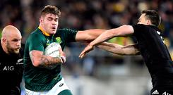 South Africa's Malcolm Marx runs away from New Zealand's Owen Franks and Ben Smith. Photo: Ross Setford/Reuters