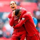 Liverpool's Virgil van Dijk (left) and Joe Gomez celebrate in front of their fans at Wembley after victory against Tottenham.