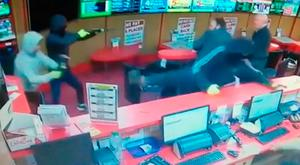 The three raiders, one armed with a shotgun, were challenged by staff at the bookmakers