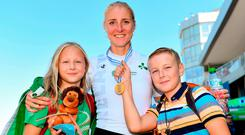 Gold: Sanita Puspure celebrates with her children Daniela (10) and Patrick (11) following her victory at the World Rowing Championships in Bulgaria. Photo: Seb Daly/Sportsfile