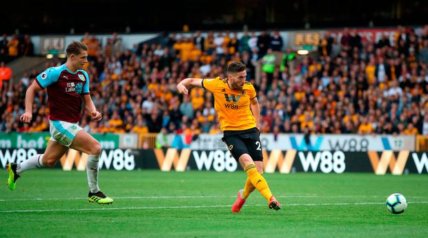 Wolverhampton Wanderers' Matt Doherty (right) has a shot on goal during the Premier League match at Molineux, Wolverhampton. PRESS ASSOCIATION Photo. Picture date: Sunday September 16, 2018. See PA story SOCCER Wolves. Photo credit should read: Nick Potts/PA Wire.