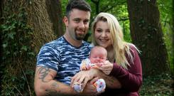Amie Berns, her partner Dayne, and their baby Harry.