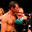Wales' Joe Calzaghe celebrates his points victory over USA's Roy Jones with his father and trainer Enzo