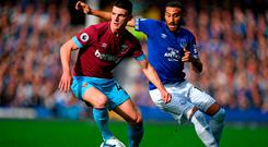 West Ham United's Declan Rice (L) vies with Everton's striker Cenk Tosun