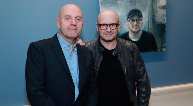 Artist Donald Teskey and director Lenny Abrahamson. In the background is Teskey's portrait of the film-maker.