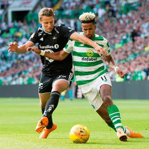 BHOYS ARE BACK: Celtic's Scott Sinclair and Rosenborg's Vegar Hedenstad battle for the ball during their Champions League qualifying match last July. Both teams will renew rivalries in the Europa League on Thursday. Photo: PA