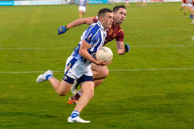 KEENLY CONTESTED: Ballyboden St Enda's Colm Basquel under pressure from St Oliver Plunkett's/Eoghan Ruadh's Declan Lally during their Dublin SFC match at Parnell Park last Friday night. Photo: Justin Farrelly