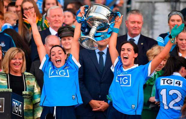 TRUE BLUES: Dublin players Sinéad Goldrick, left, and Hannah O'Neill celebrate with the cup after their TG4 All-Ireland Ladies Football Senior Championship Final win over Cork last Sunday. Photo: Brendan Moran/Sportsfile