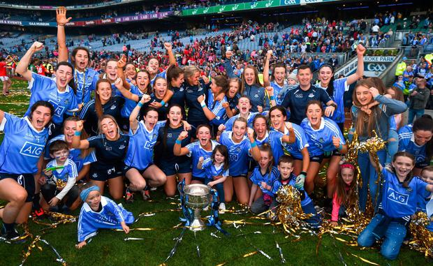HEROES: The Dublin team celebrate with the Brendan Martin Cup following the TG4 All-Ireland Ladies Football Senior Championship Final victory over Cork at Croke Park. Photo: David Fitzgerald/Sportsfile