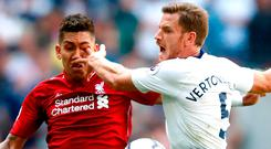 Jan Vertonghen of Tottenham Hotspur pokes Roberto Firmino of Liverpool in the eye as they battle for the ball. Photo: Getty Images