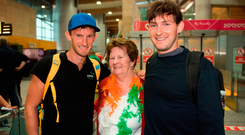Family welcome: Champion rowers Gary and Paul O'Donovan were met at Cork Airport by their grandmother Mary Doab. Photo: Eóin Noonan/Sportsfile