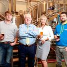 Cillian and Nick Fahy pictured with their mum and dad, Pat and Siobhan in their Larkins Brewery. Picture: Frank McGrath