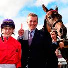 Jockey Ronan Whelan (left) celebrates winning the Moyglare Stud Stakes on Skitter Scatter alongside trainer Patrick Prendergast on Sunday at the Curragh. Photo: PA