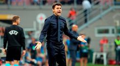 Tottenham coach Mauricio Pochettino calls out to his players during the Champions League, group B soccer match between Inter Milan and Tottenham Hotspur, at the Milan San Siro Stadium