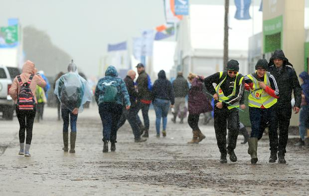 National Ploughing Championships 2018. People run for cover in the heavy rain at the championships. Picture; Gerry Mooney