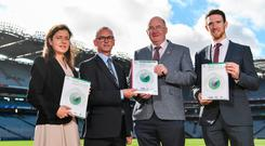 ESRI senior research officer Elish Kelly, Director of the ESRI Alan Barrett, GAA president John Horan and GPA CEO Seamus Hickey in Croke Park for the launch of the Report into Playing Senior Inter-county Gaelic Games. Photo: Sportsfile